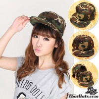 Hip hop helmet with green army camouflage on the back side is SNAPBACK.